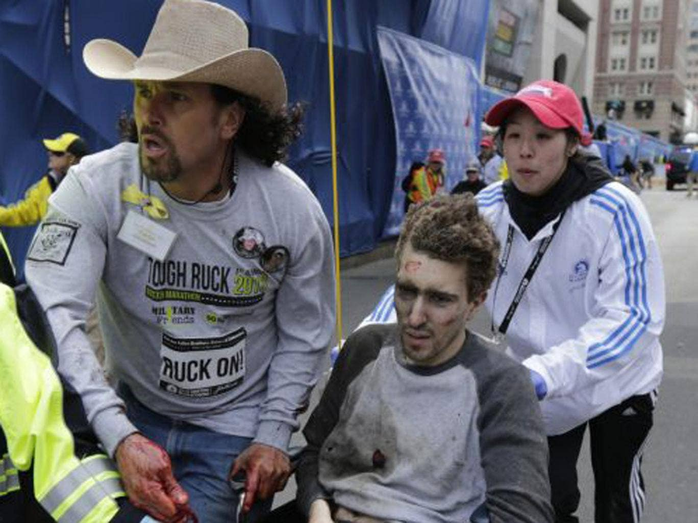 Jeff Bauman being helped from the carnage after the explosion