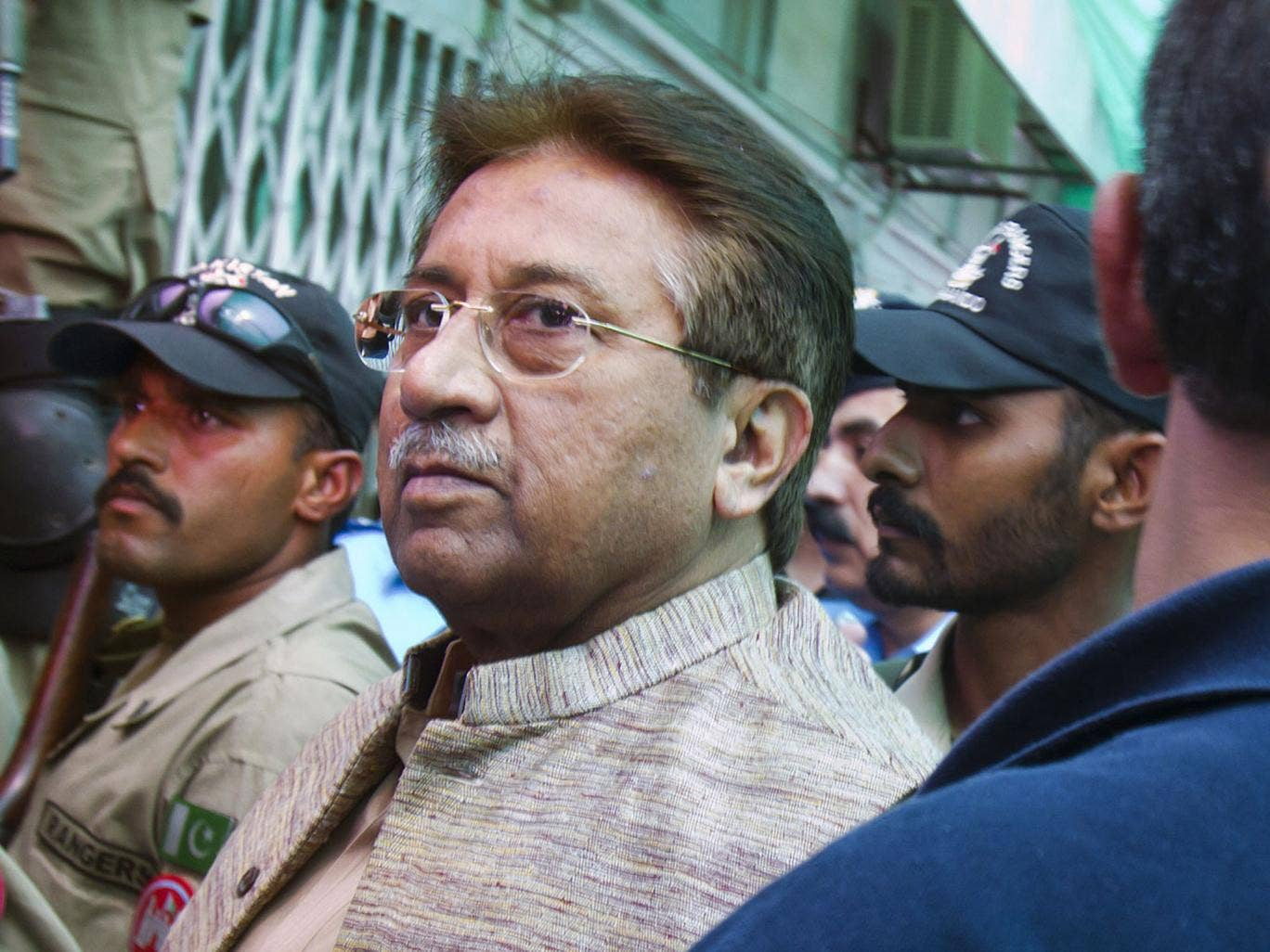 Marked man: Pervez Musharraf arrives at court in Islamabad yesterday
