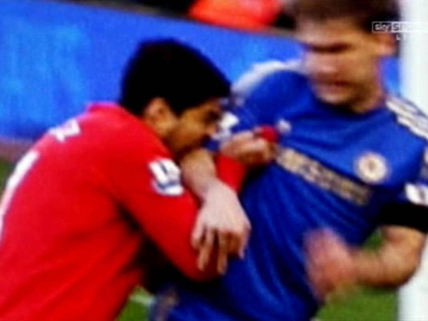 A screen grab of Luis Suarez biting Chelsea defender Branislav Ivanovic