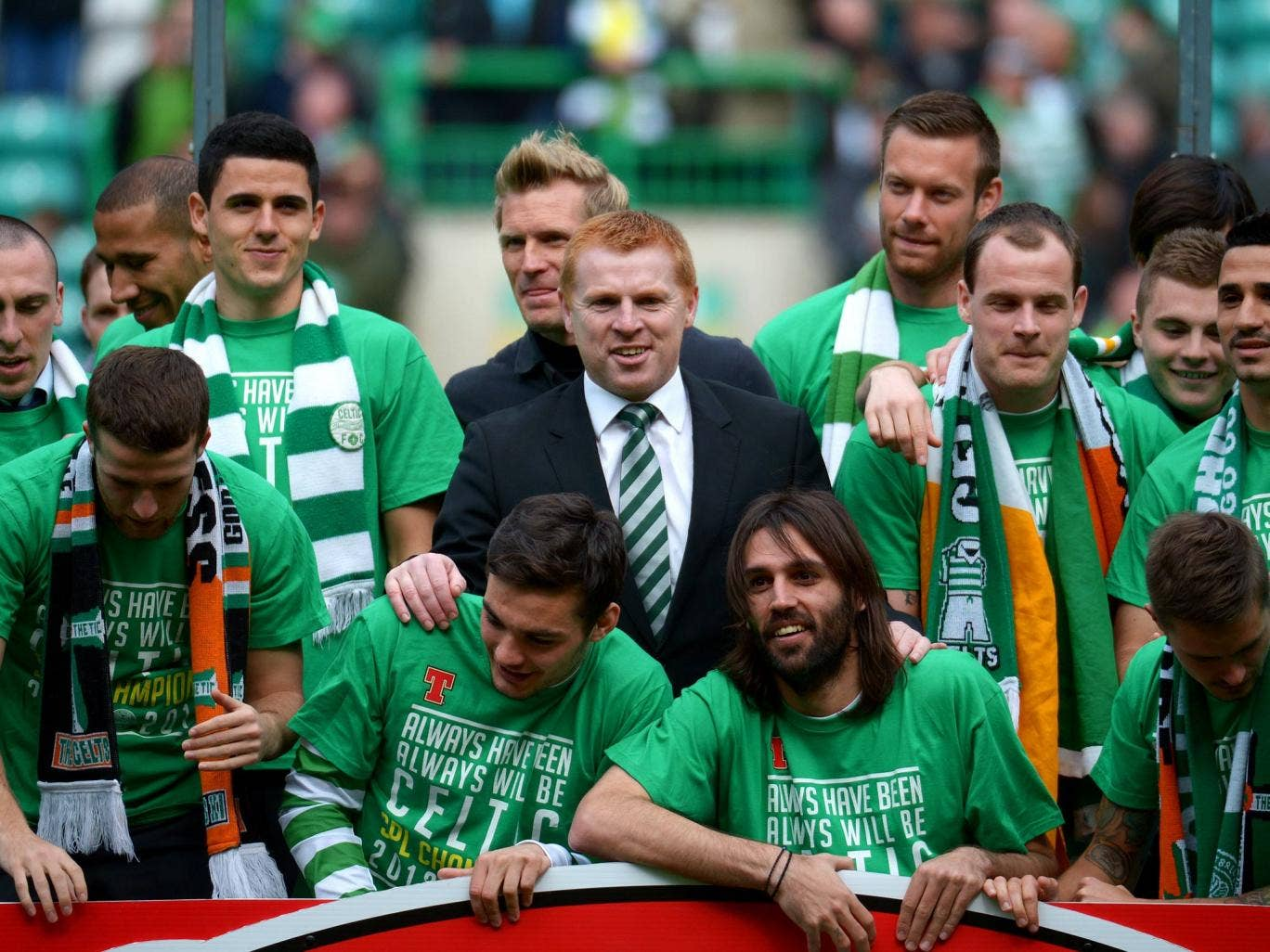 Neil Lennon is at the centre of celebrations after Celtic clinch the title