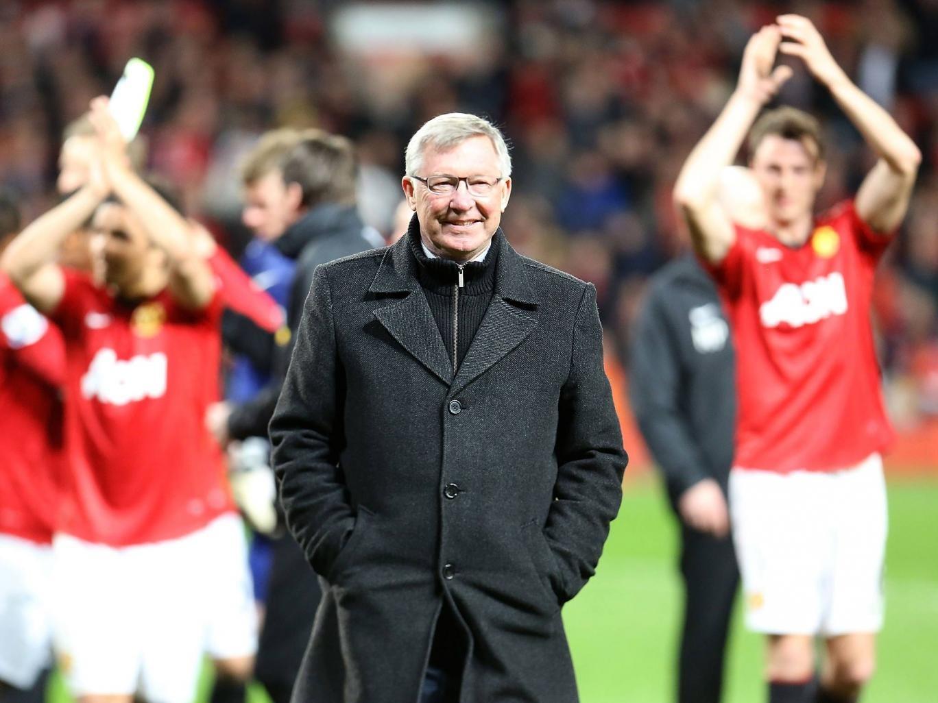 Sir Alex Ferguson joins in the celebrations
