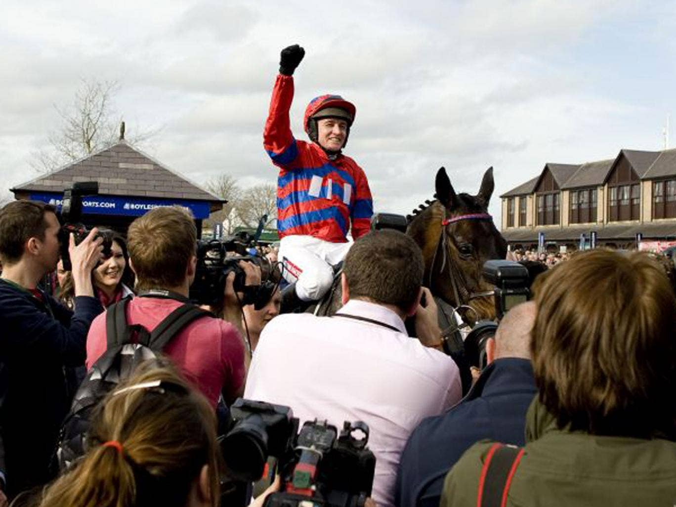 Barry Geraghty riding Sprinter Sacre, celebrating his win at The Boylesports.com Champion Chase (Getty)