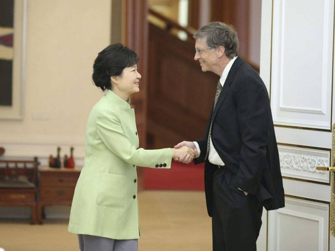 The Microsoft founder has been accused of disrespecting the South Korean President, Park Geun-hye, after he was pictured shaking hands with her - with his other hand firmly in his pocket.