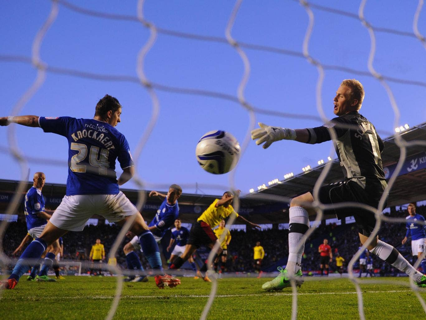 Anthony Knockaert and Kasper Schmeichel of Leicester can't stop Troy Deeney of Watford scoring to make it 1-0