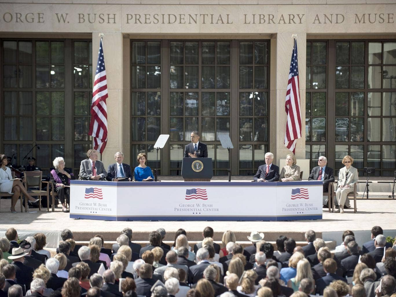Power trip: From left to right: the Bushes, Barack Obama, Clintons and Carters honour 'Dubya' in Texas