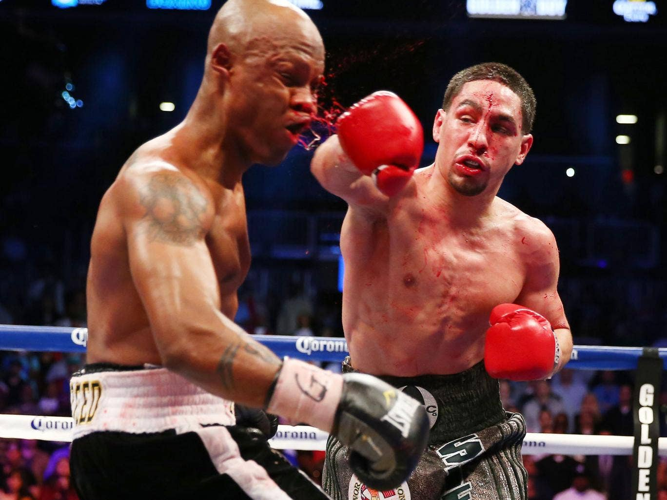 Danny Garcia, right, who could face Amir Khan in the future, lands a heavy blow on Zab Judah in their bloody light welterweight title clash