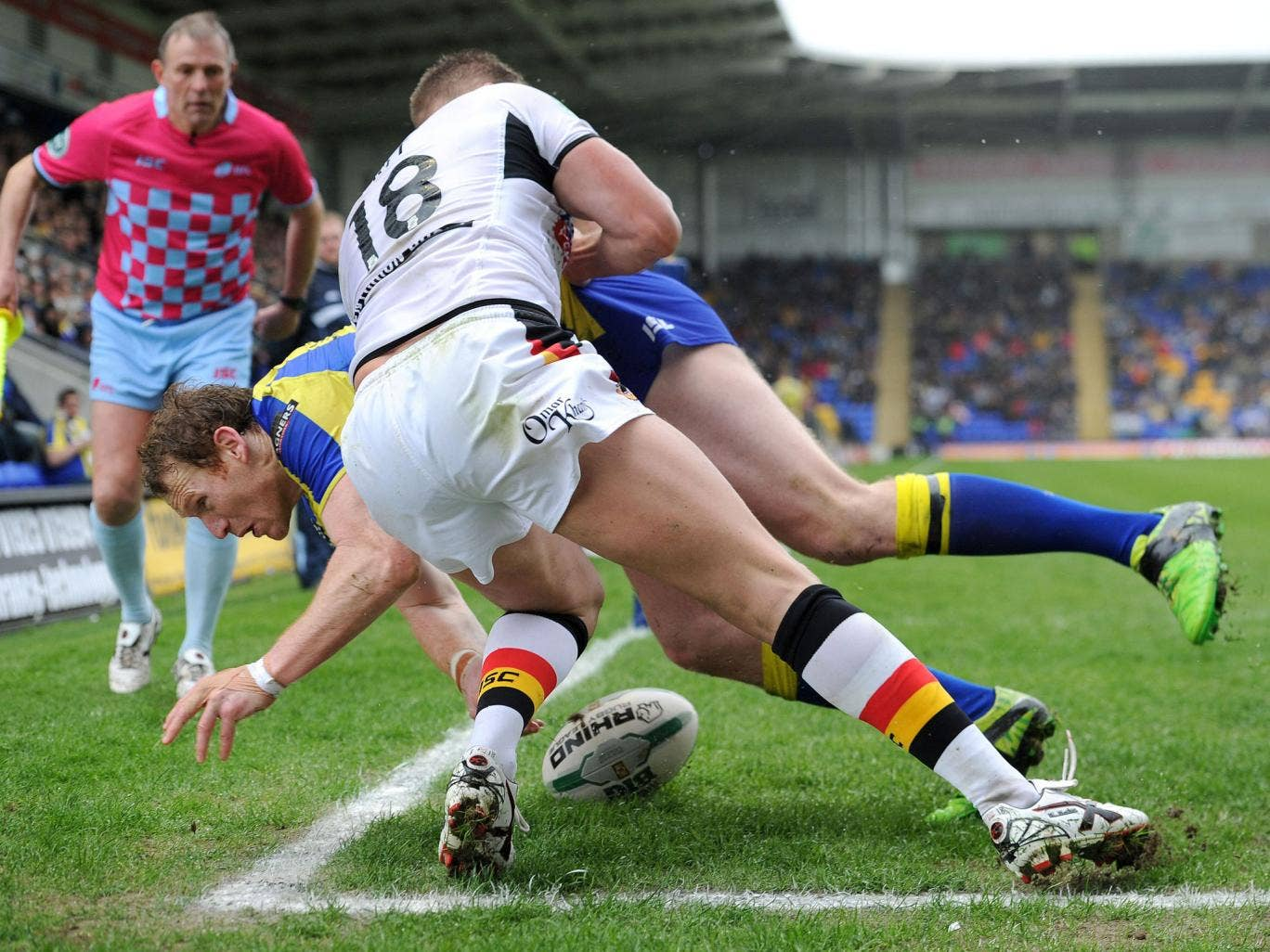 Warrington Wolves' Joel Monaghan goes over for a try past Bradford Bulls Michael Platt during the Super League match at the Halliwell Jones Stadium, Warrington
