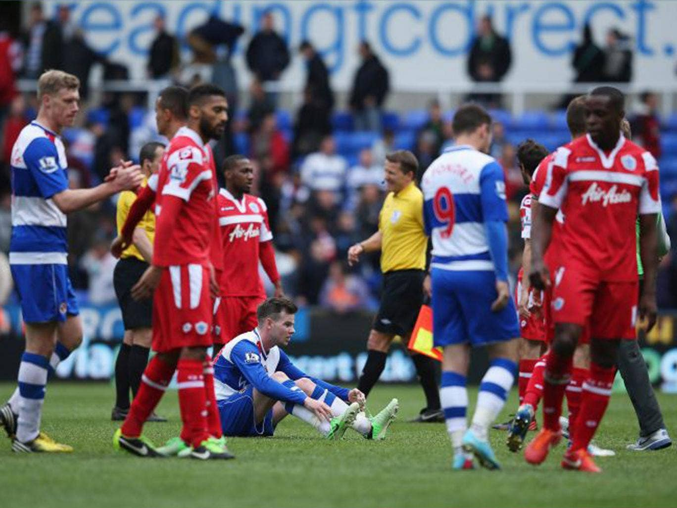 Danny Guthrie of Reading sits on the ground dejected after his team and QPR were relegated during the Barclays Premier League match between Reading and Queens Park Rangers at the Madejski Stadium