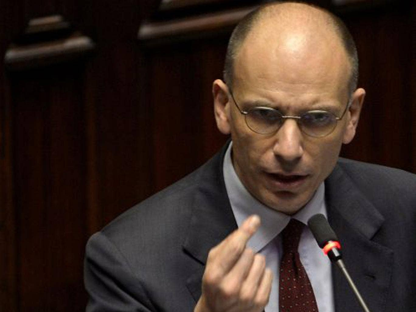Enrico Letta has said his coalition will ease up on austerity in order to drag the pivotal eurozone economy out of its downward spiral