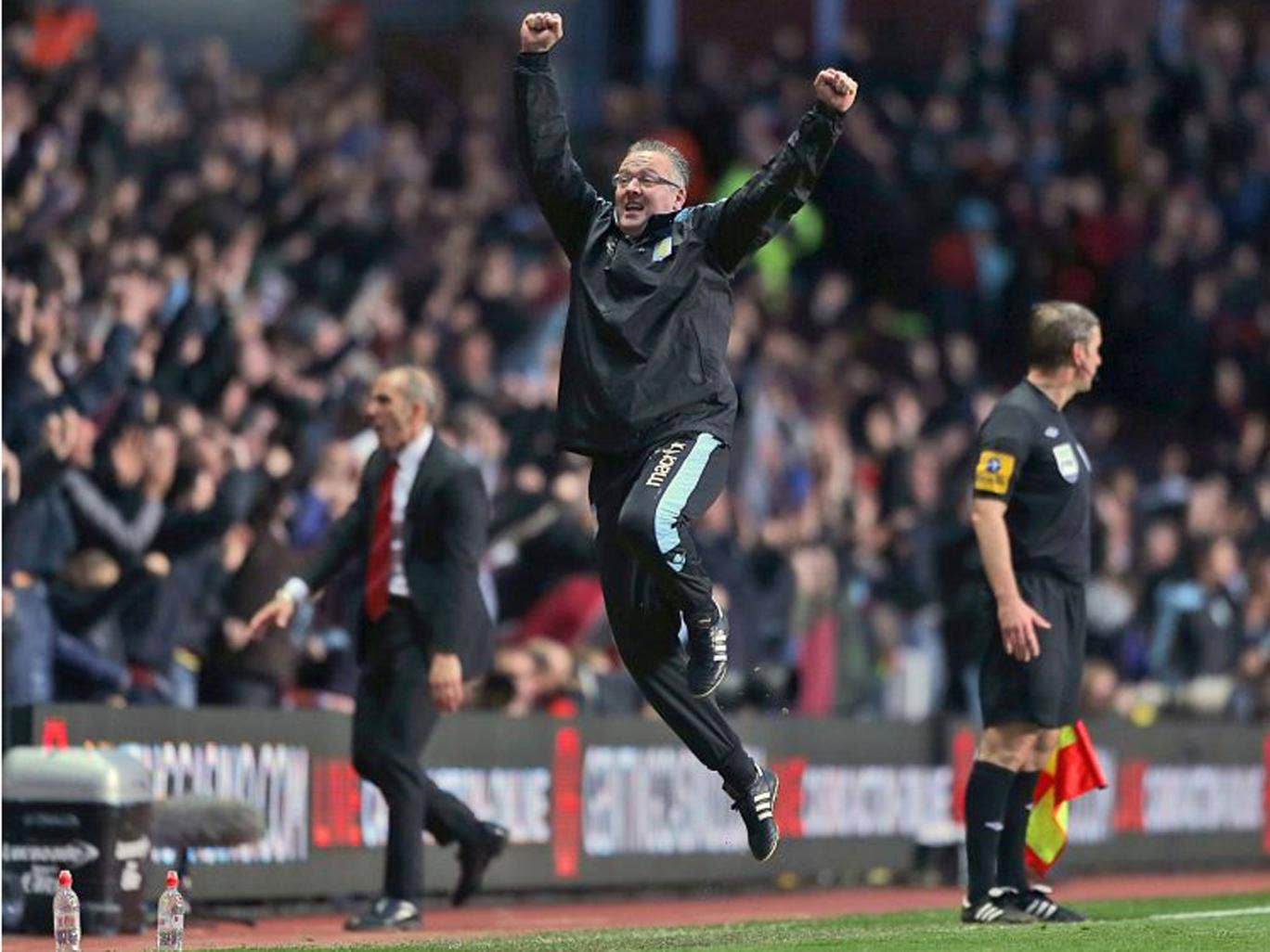 Aston Villa manager Paul Lambert, centre, celebrates on the touchline after Ron Vlaar scores his side's first goal of the game against Sunderland during the English Premier League soccer match at Villa Park, Birmingham