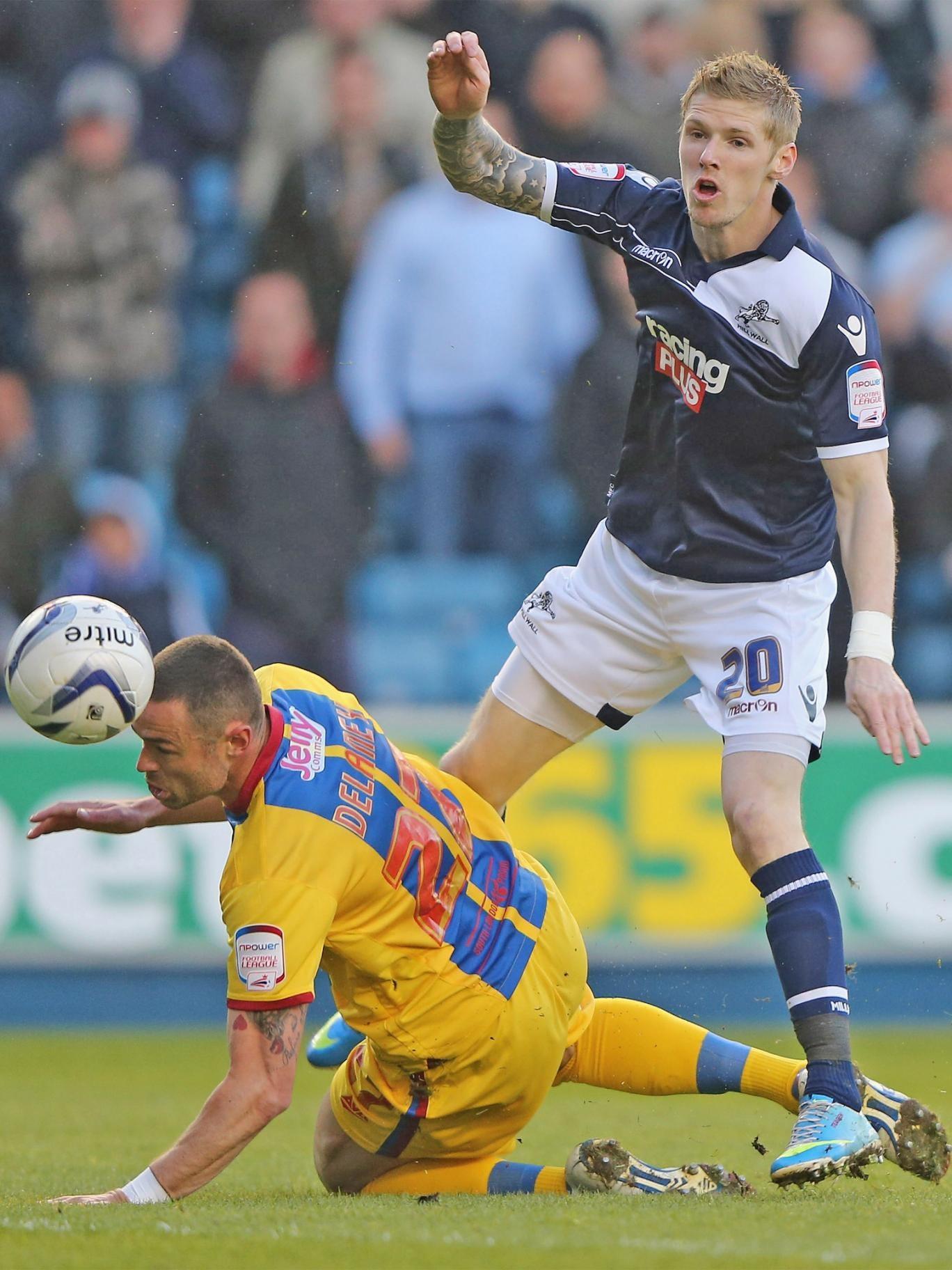 Millwall striker Andy Keogh has a shot blocked by Damien Delaney