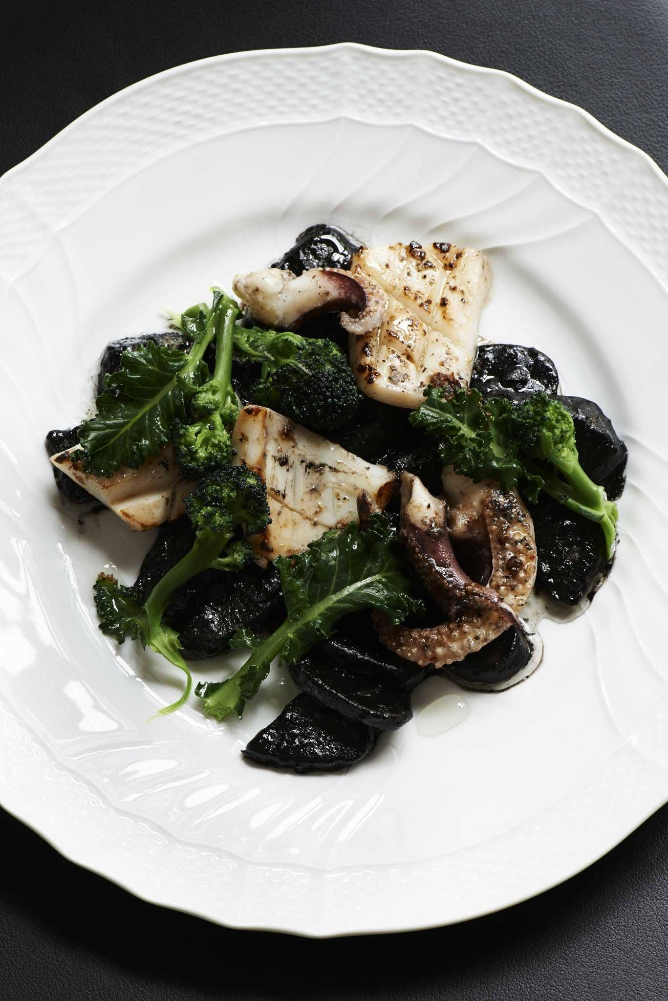 Ink potatoes with sprouting broccoli and squid