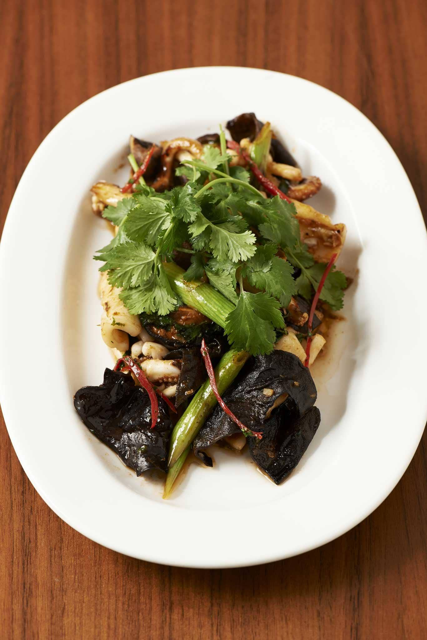 Stir fried squid with green onions, ginger and mushrooms
