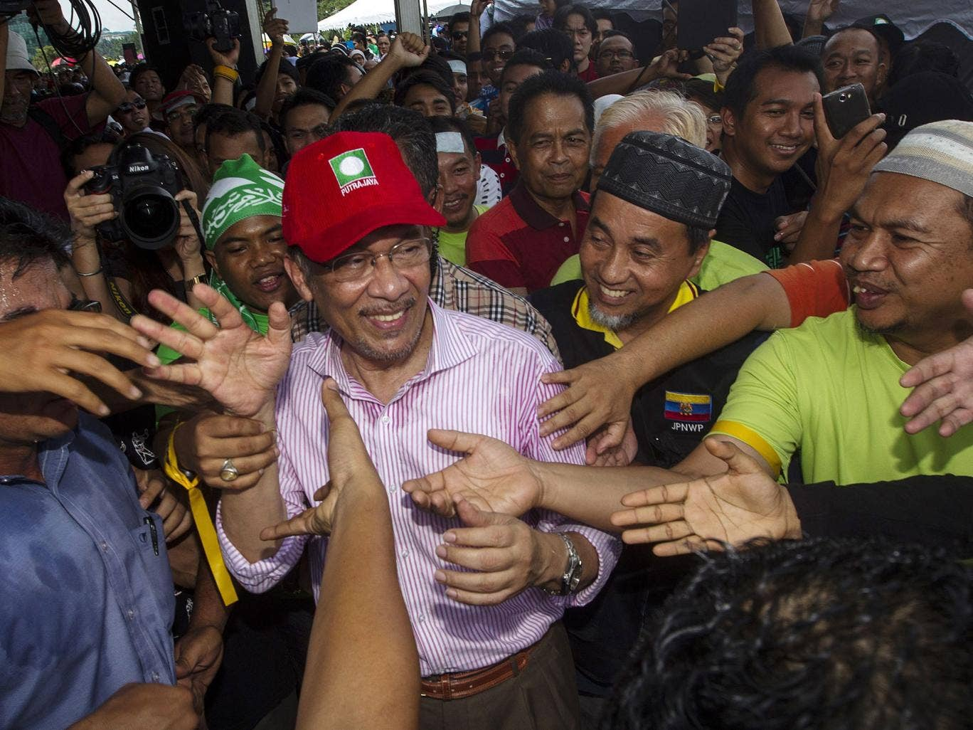 Opposition leader Anwar Ibrahim claims at least 40,000 people had been flown in for the election