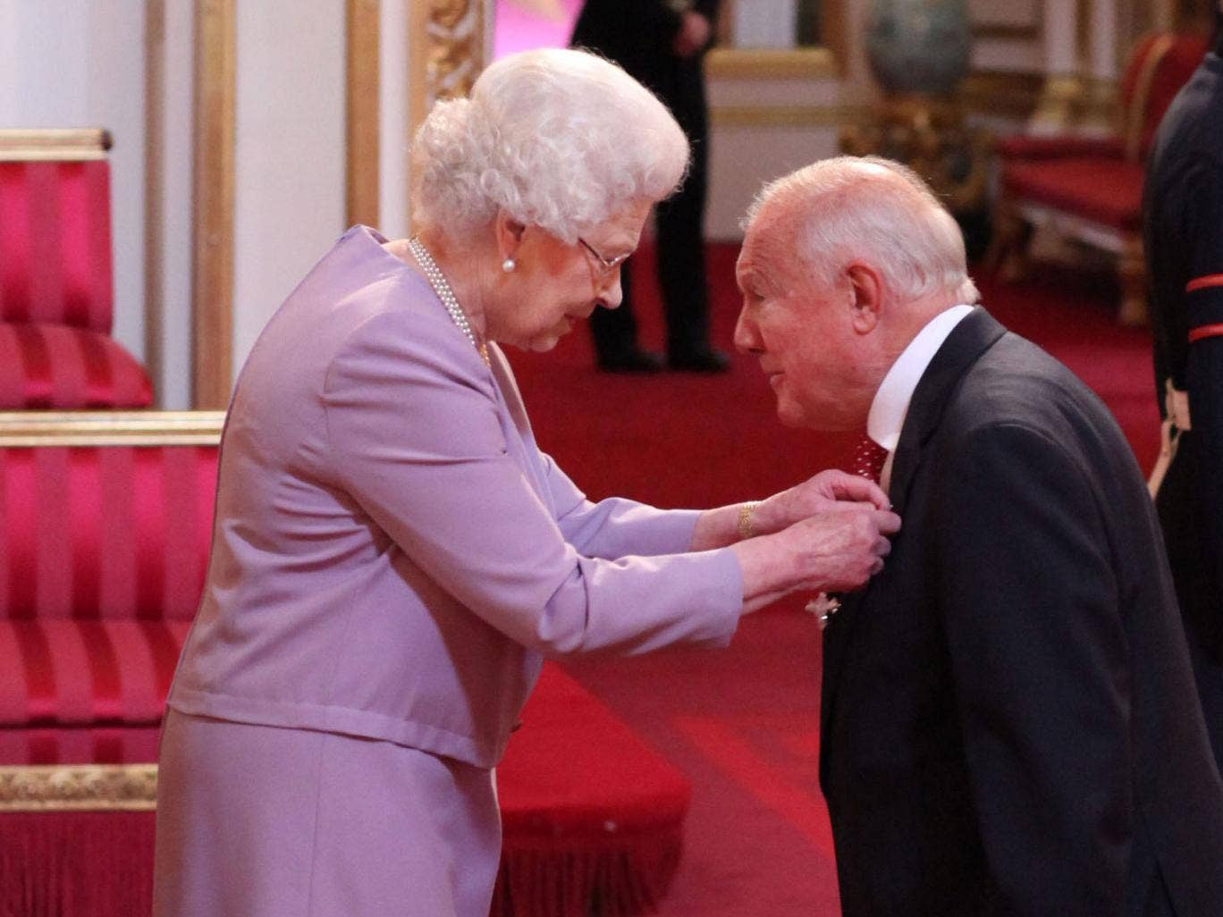 Stuart Hall is made an OBE by the Queen in March last year