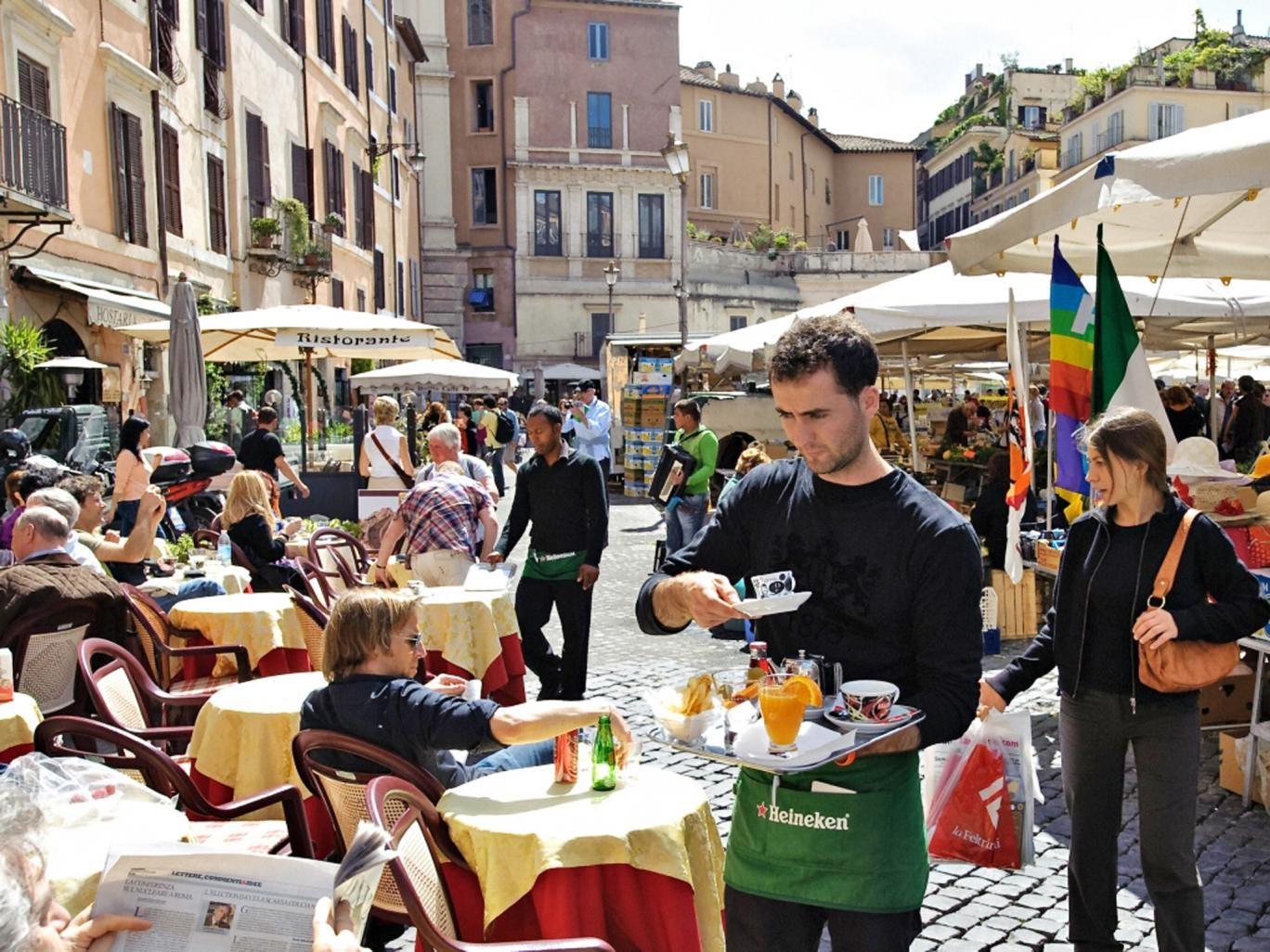 Square meal: diners in the Campo de Fiori in Rome