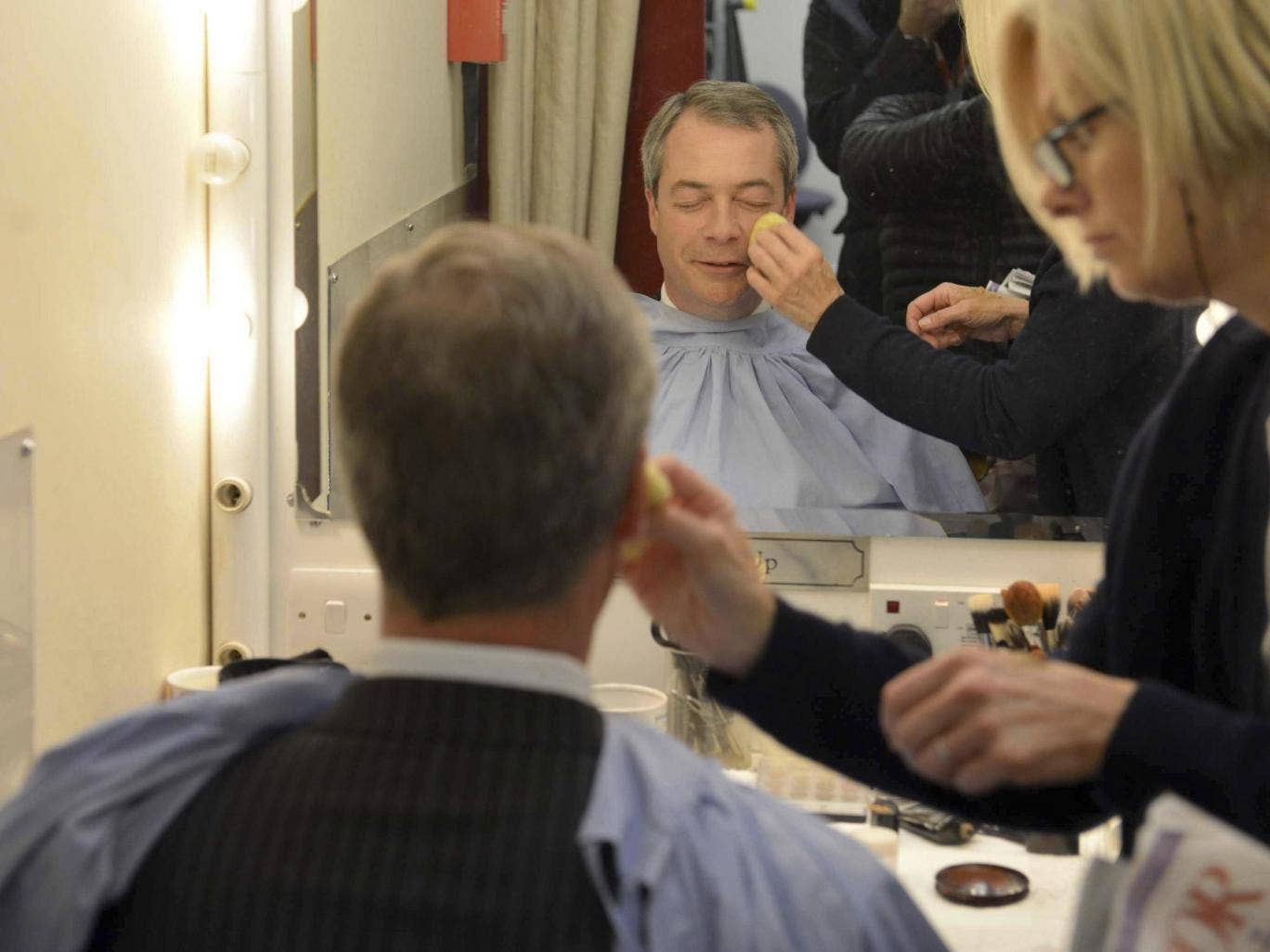 "UK Independence Party (UKIP) leader Nigel Farage sits wearing make-up before appearing in the ""BBC Vote 2013"" studio at Milbank in London"