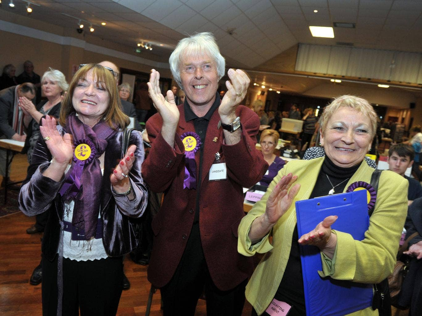 UKIP supporters celebrate as UKIP's Colin Guyton wins the Drybrook and Lydbrook seat, at the count in Oaklands Snooker Club in Cinderford, Gloucestershire