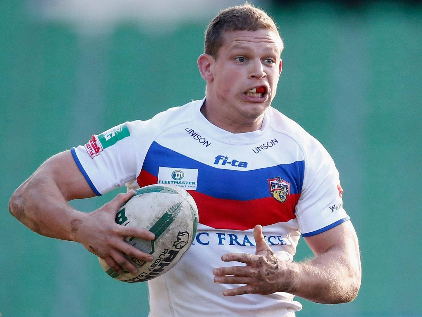 In the hunt: Wakefield's Peter Fox scored two tries against the Dragons