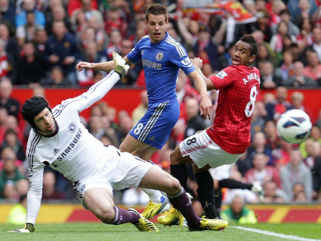 Petr Cech keeps out a Manchester United effort while Azpilicueta and Anderson look on