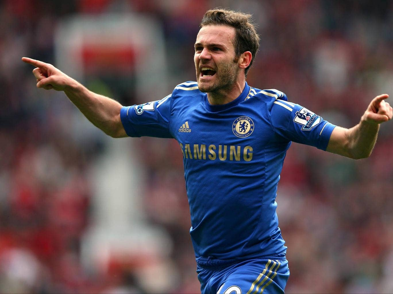 Juan Mata celebrates as his strike deflected off Phil Jones to give Chelsea a 1-0 win against Manchester United