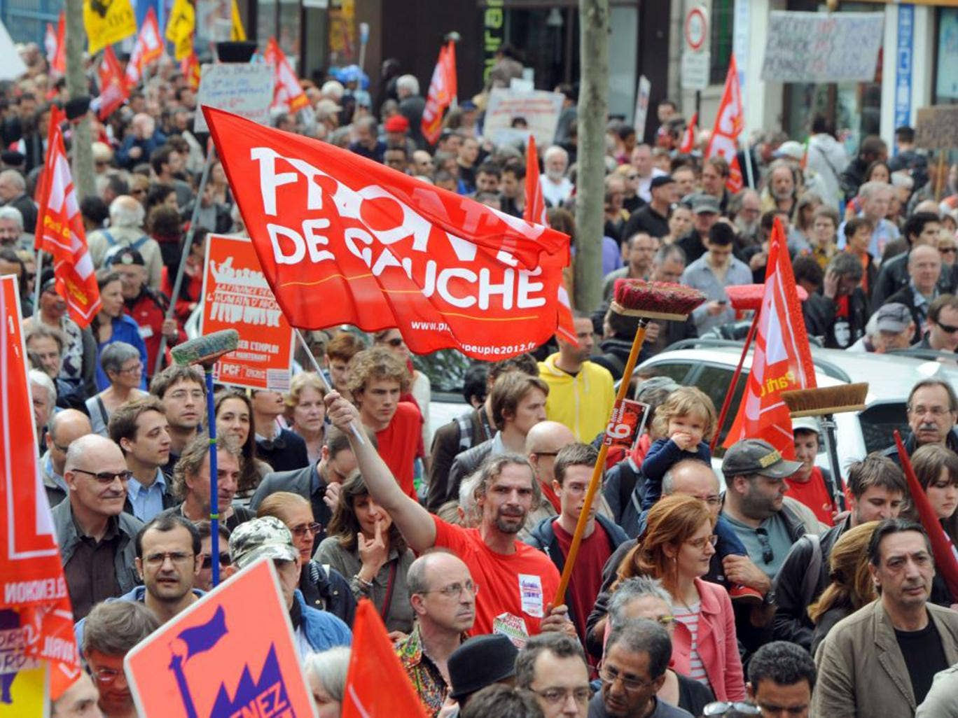 Tens of thousands of supporters of leftist parties marched through central Paris to express disappointment with President Francois Hollande's first year in power