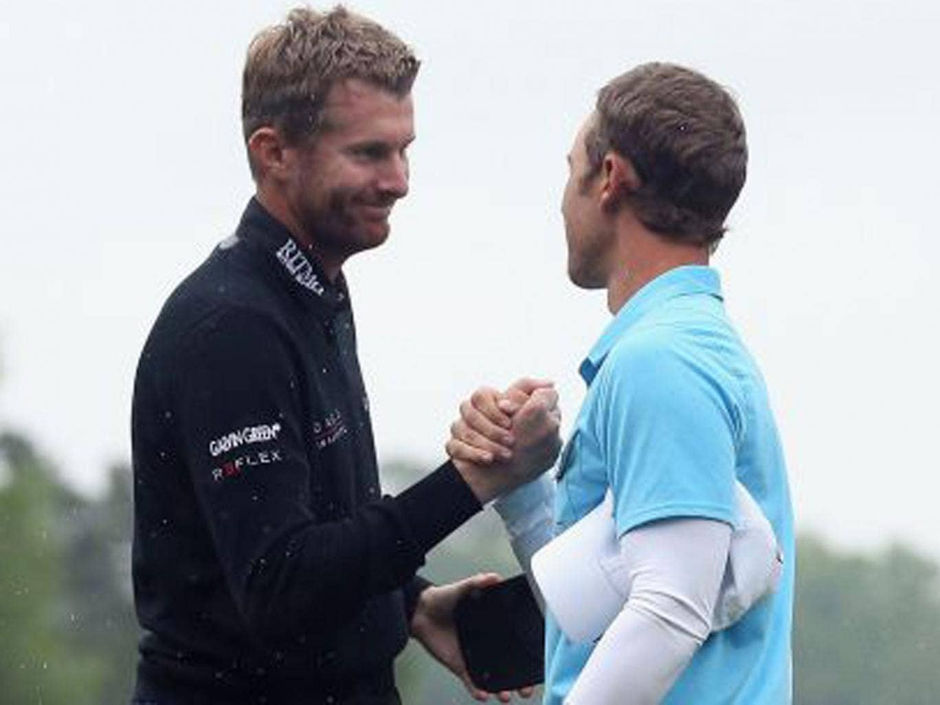 England's David Lynn (left) shakes hands with Derek Ernst after losing in a play-off