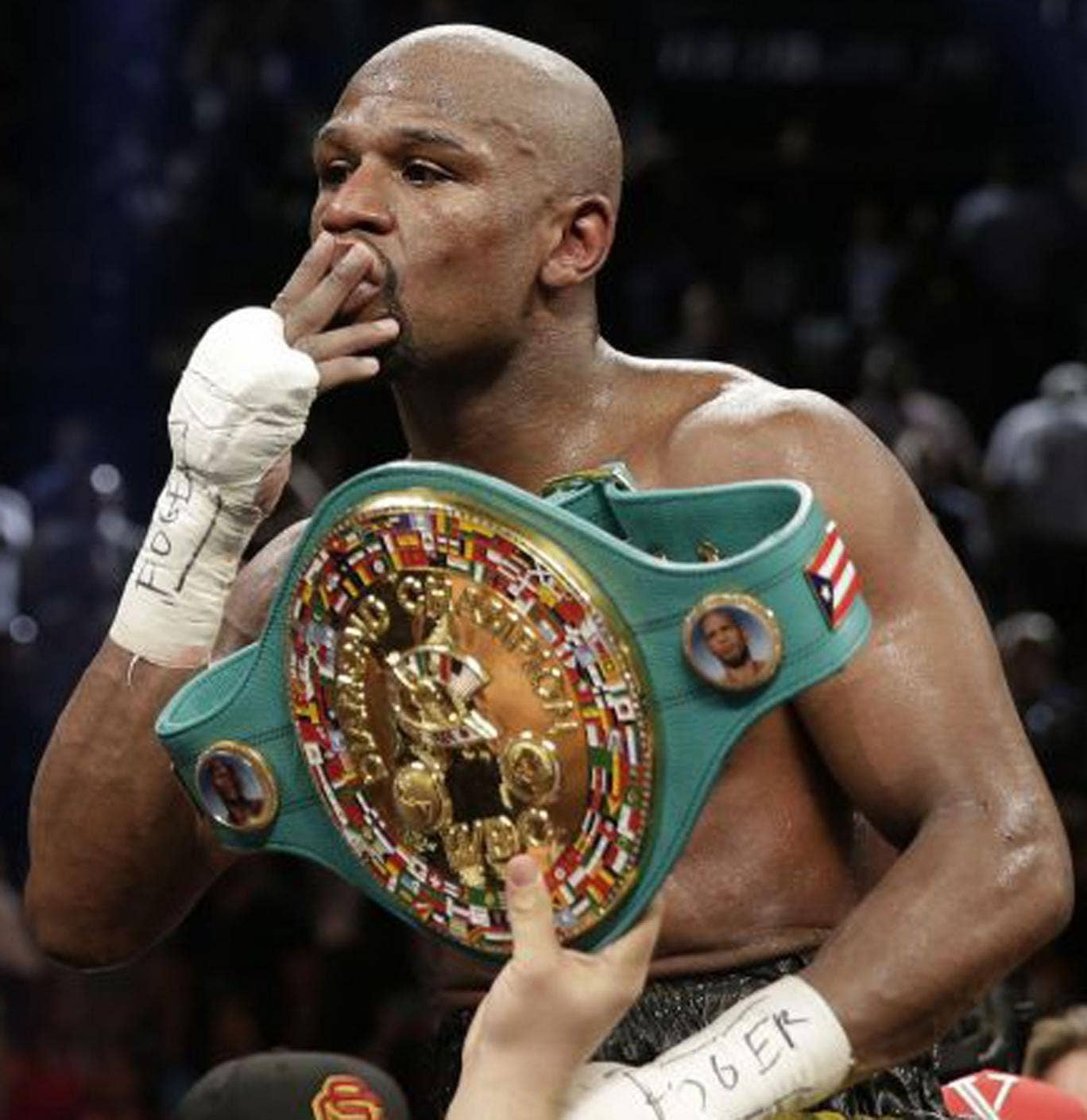 Floyd Mayweather celebrates another victory on Saturday