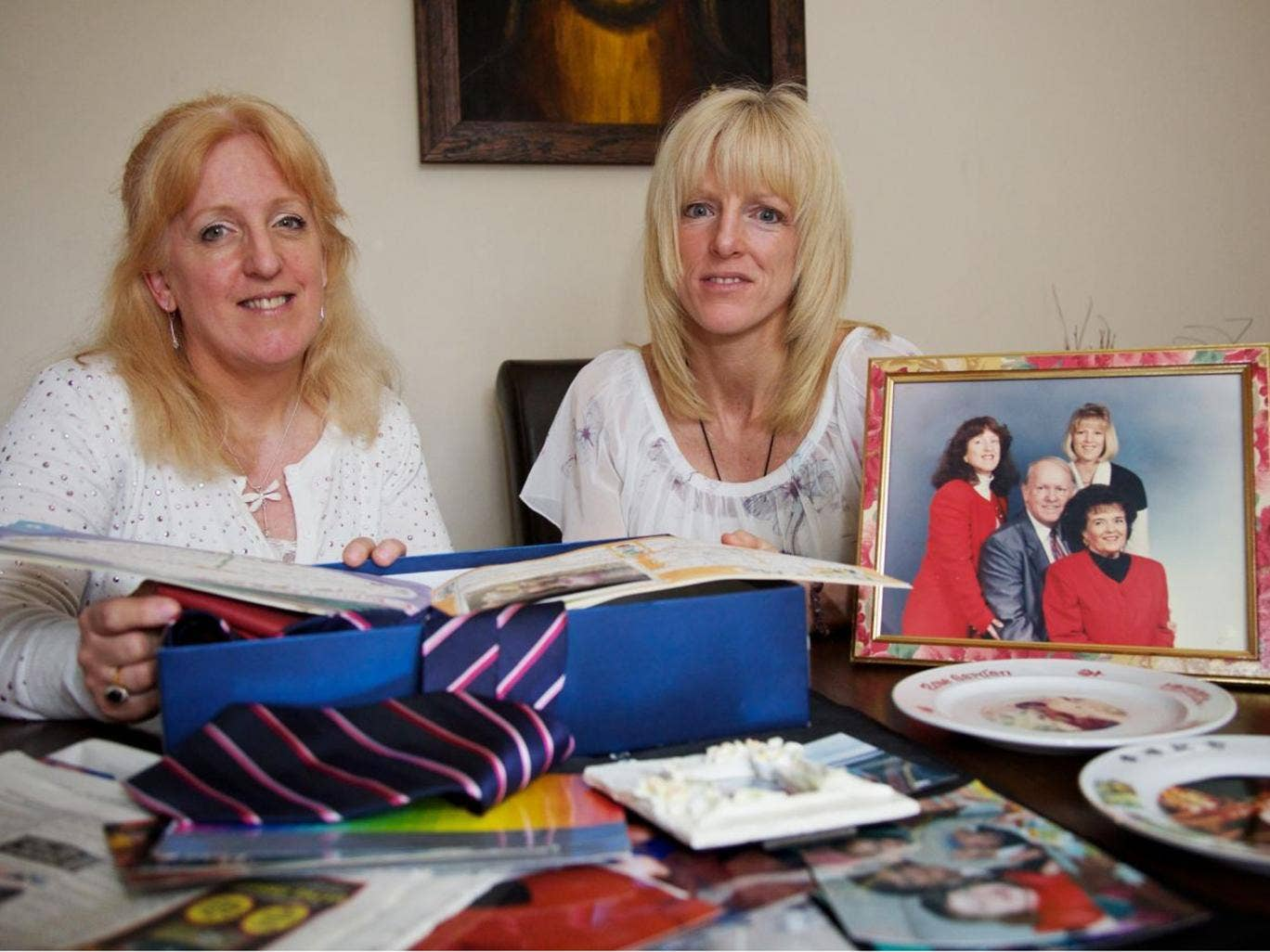 Nicky Locking, left, and Lisa Young, daughters of the Glovers, beside a picture of the family in 1994