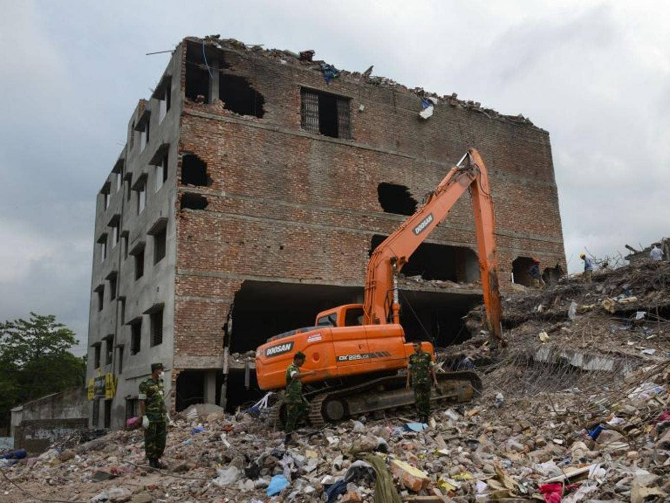 Workers and army personnel use heavy machinery to clear the site and recover bodies of victims from the rubble of the garment factory building collapse near Dhaka, Bangladesh