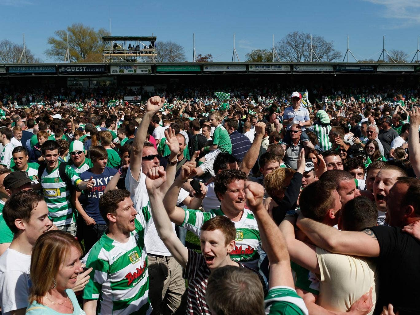 Yeovil fans flood the pitch at Huish Park after victory over Sheffield United to put them in the League One play-off final