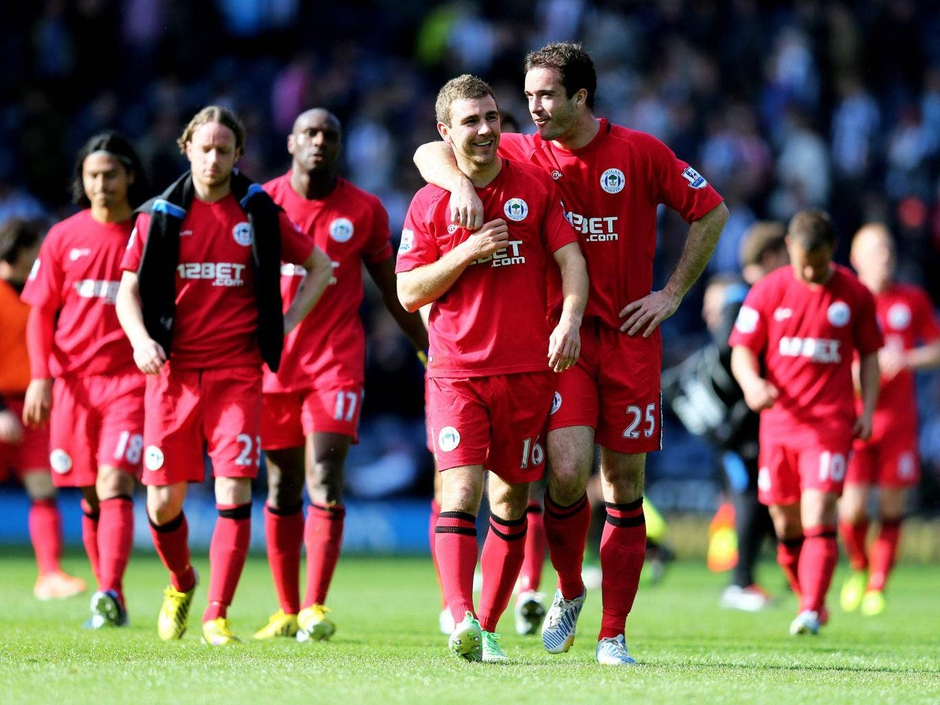 James McArthur and Roman Golobart of Wigan celebrate their team's 3-2 victory over West Brom