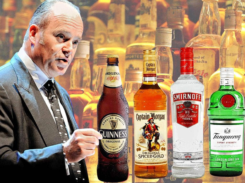 Diageo's outgoing chief executive, Paul Walsh, with some of the company's products