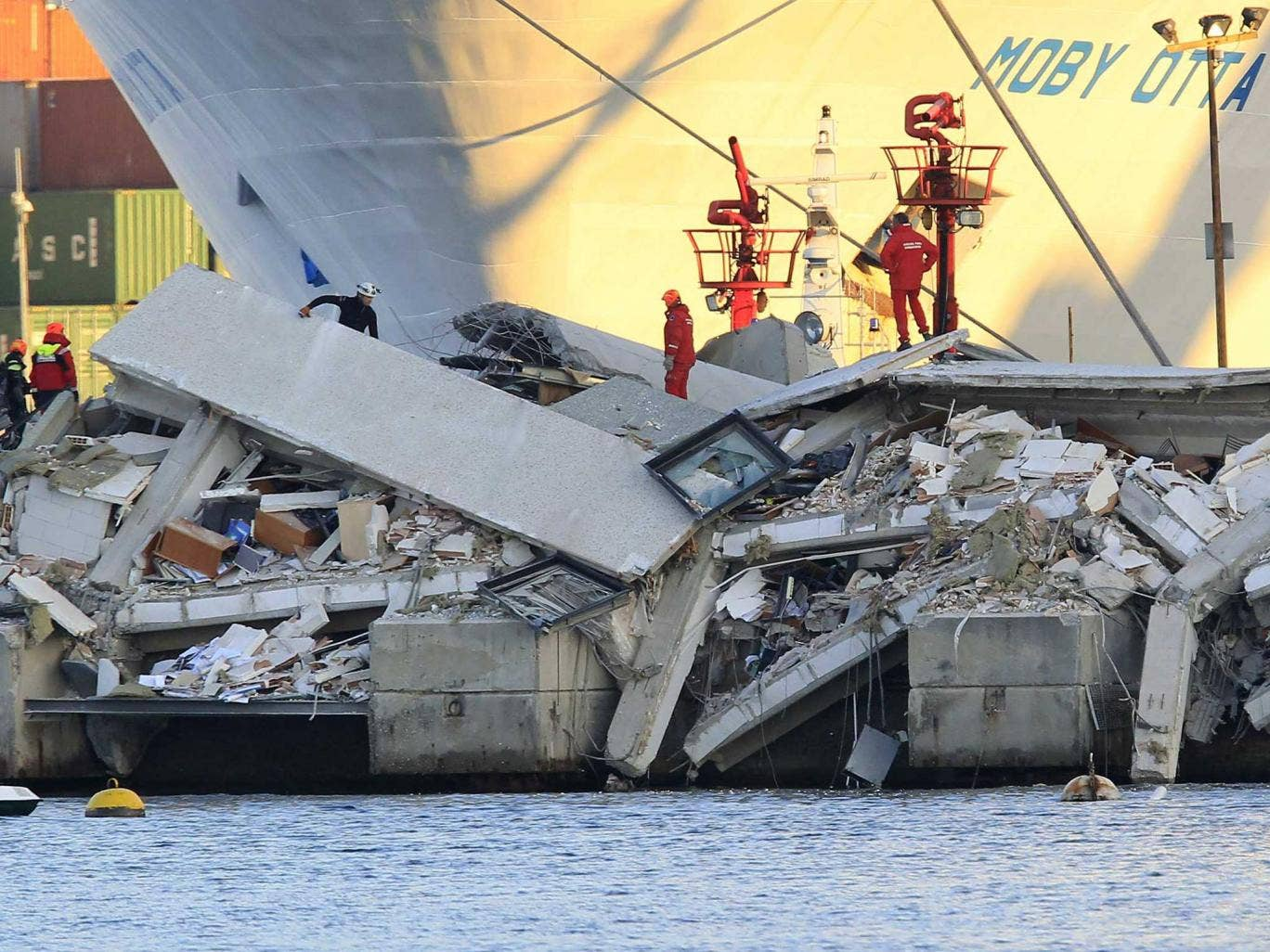 The collapsed control tower is pictured at Genoa's port