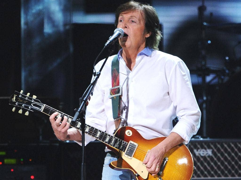 Sir Paul McCartney performing on stage