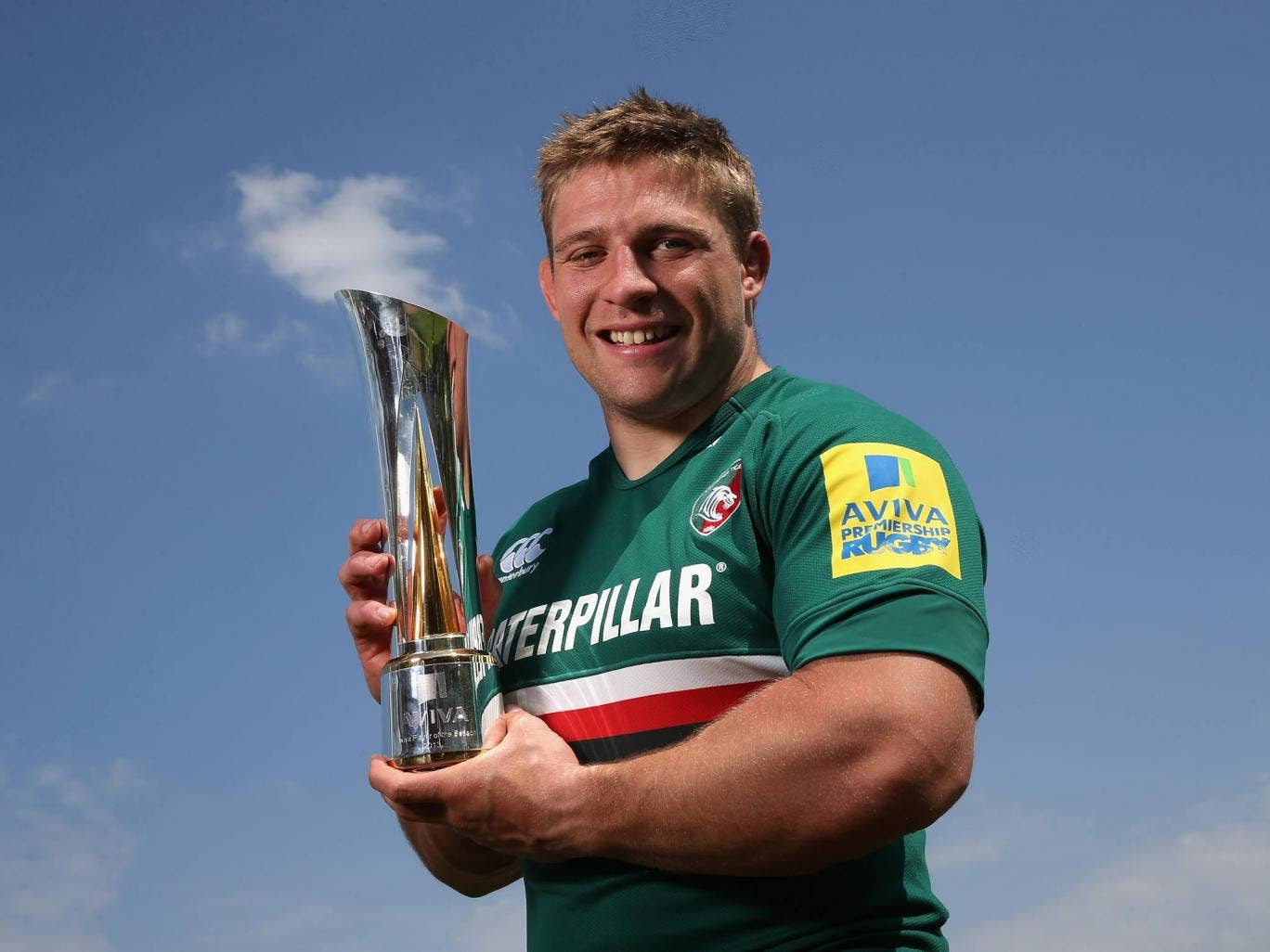 Tom Youngs of Leicester Tigers holds the Aviva Premiership Rugby Player of the Season trophy at the Leicester Tigers training ground