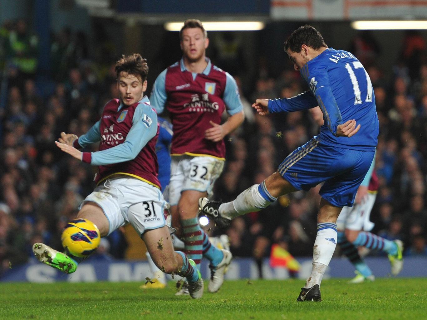 Chelsea's Belgian midfielder Eden Hazard (R) scores their seventh goal past Aston Villa's Australian midfielder Chris Herd