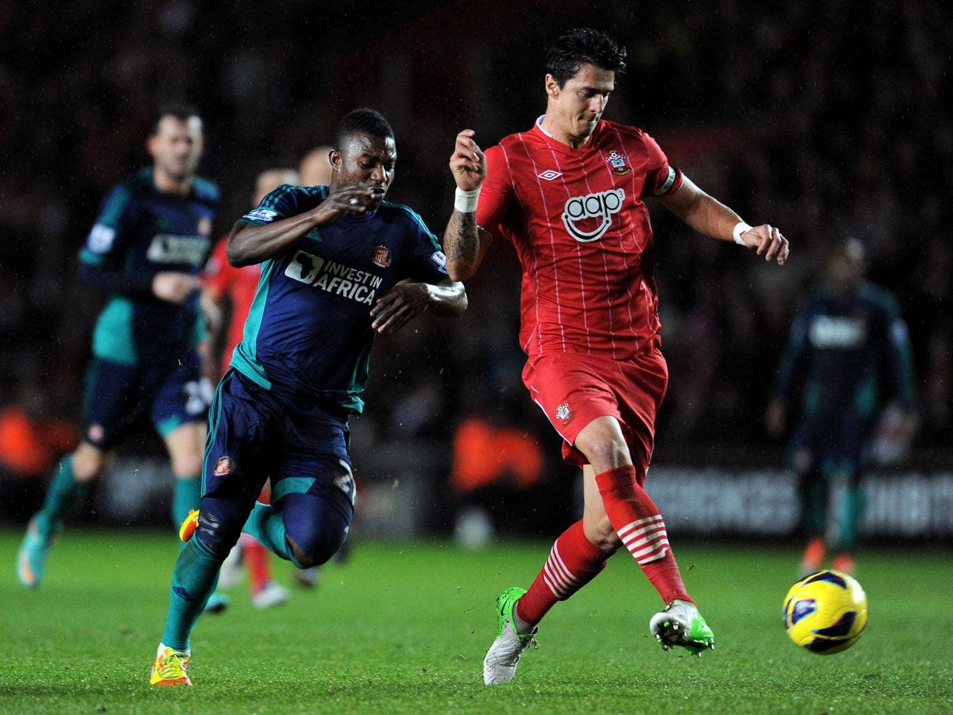 Jose Fonte of Southampton hold soff the challenge from Stephane Sessegnon of Sunderland
