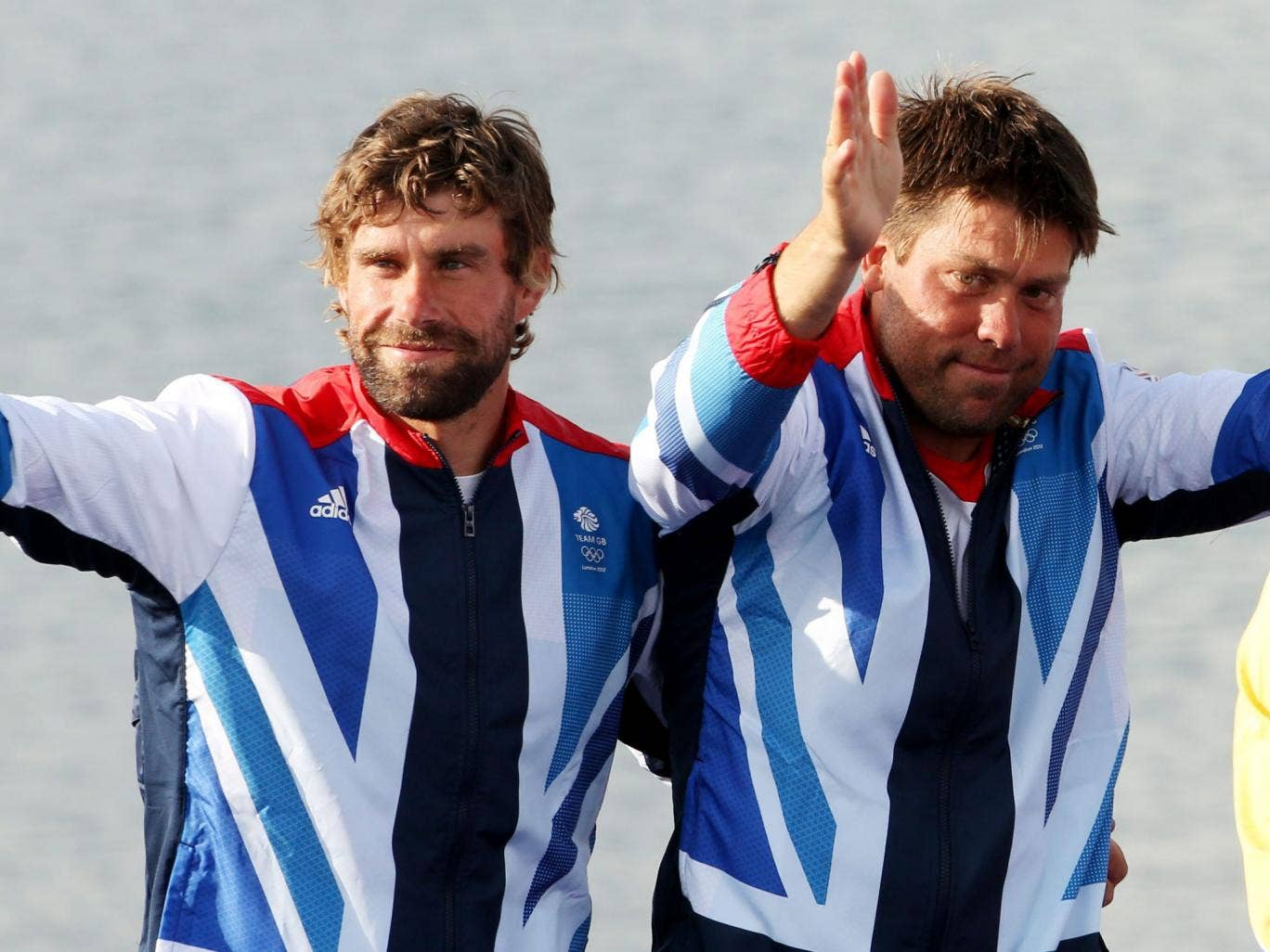 Simpson, right, and Iain Percy step up to the Olympic podium at Weymouth last year