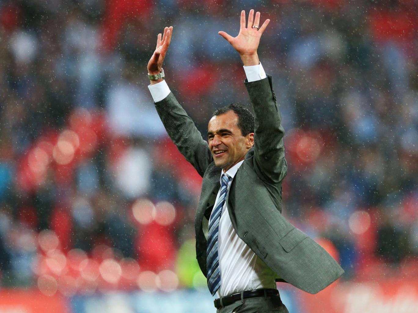 Roberto Martinez celebrates Wigan's famous FA Cup triumph in the pouring rain