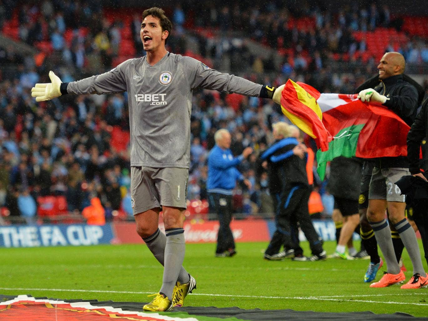 Joel Robles of Wigan Athletic celebrates victory