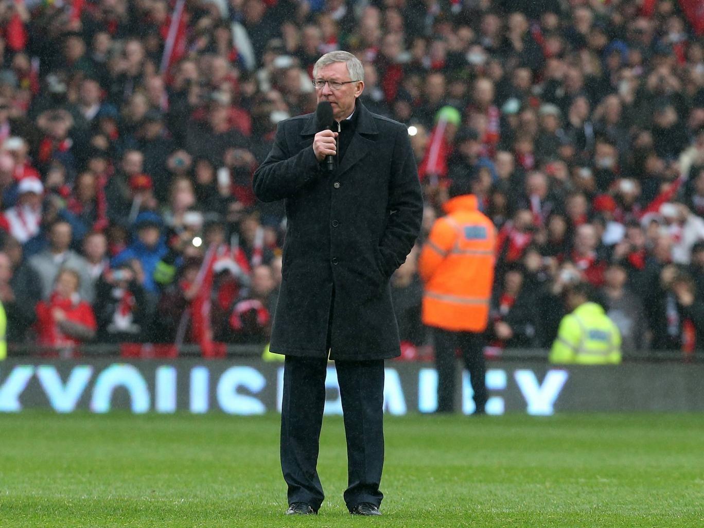 Sir Alex Ferguson addresses the onlooking Manchester United crowd
