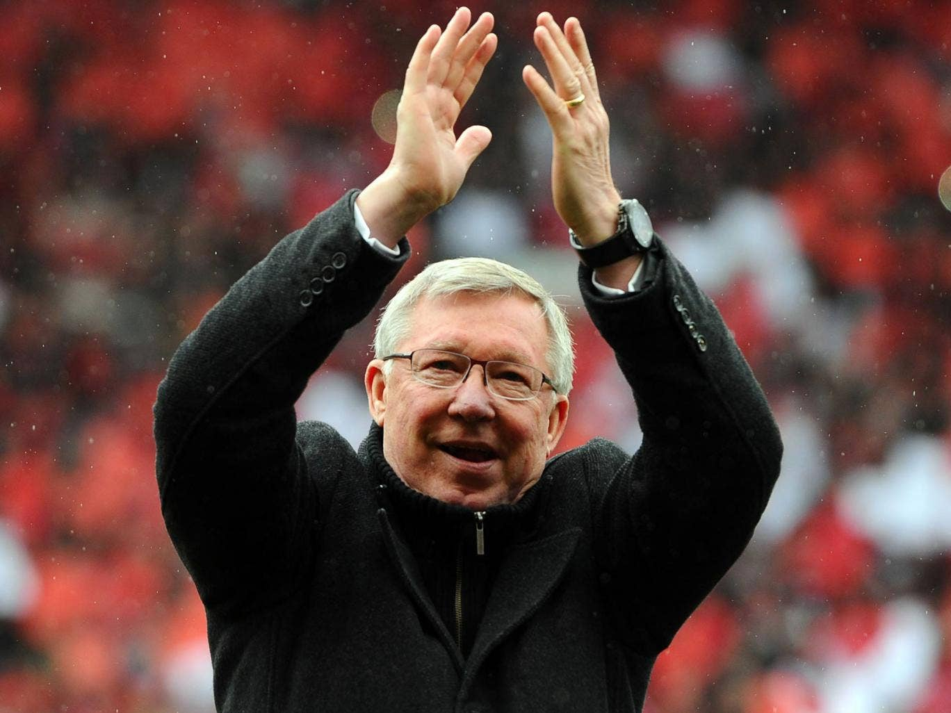 Manchester United's Scottish manager Alex Ferguson applauds as he arrives on the field (Andrew Yates/AFP/Getty Images)