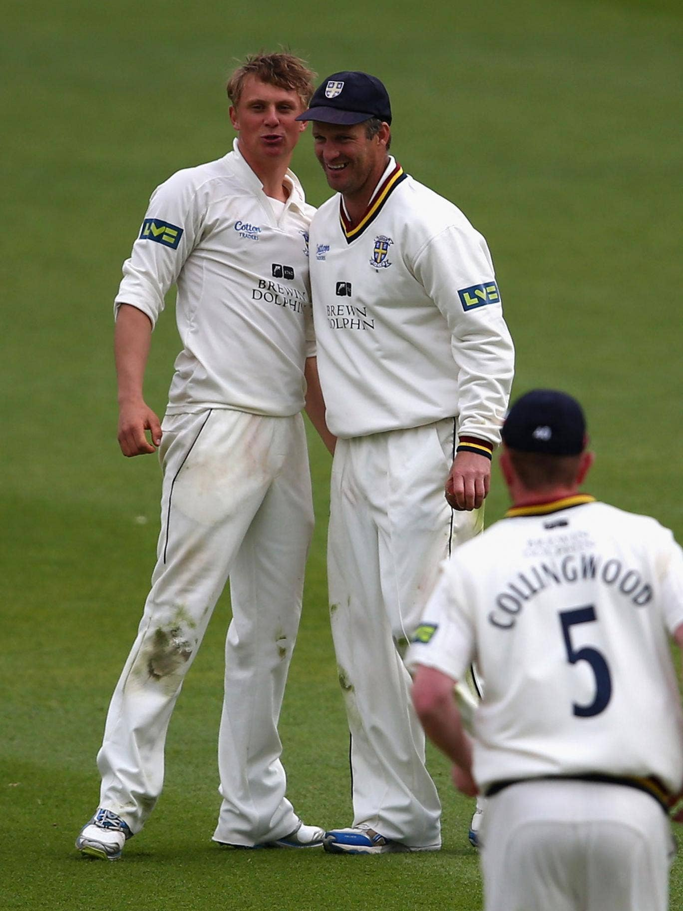 Scott Borthwick, left, celebrates taking another Surrey wicket