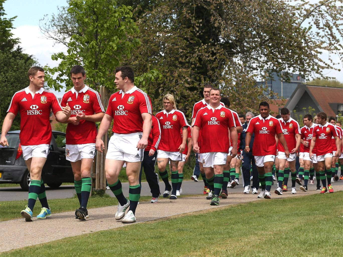 The Lions squad walking through Syon Park in London yesterday after getting their tour kit