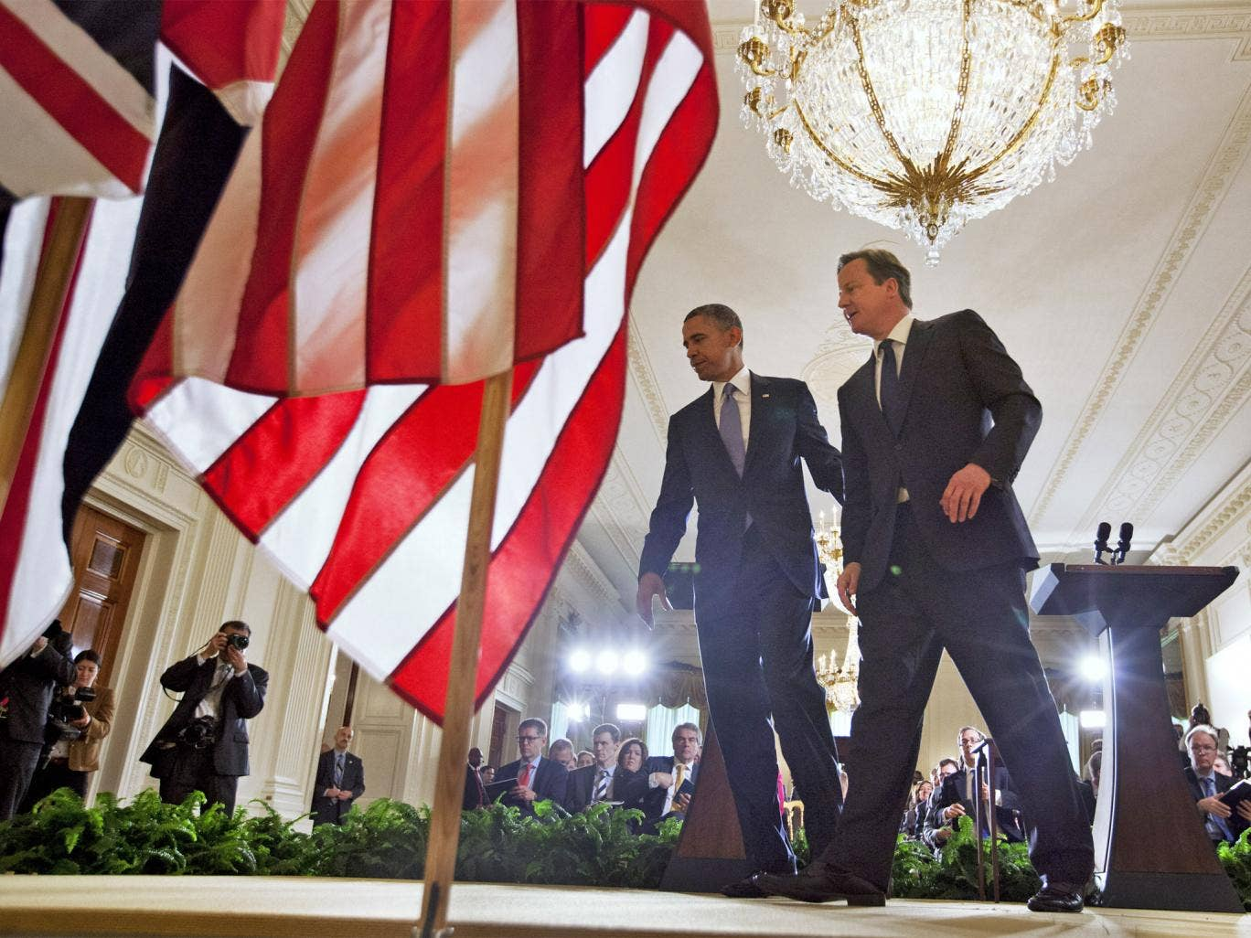 Barack Obama and David Cameron leave their news conference in East Room of the White House
