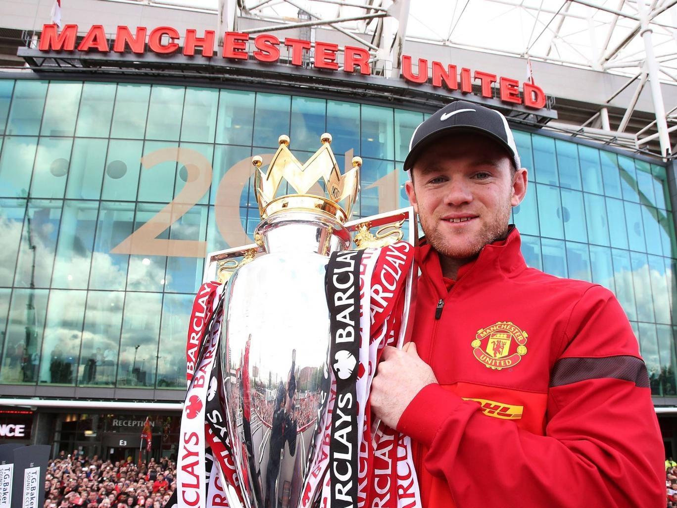Wayne Rooney celebrates with the Premier League trophy