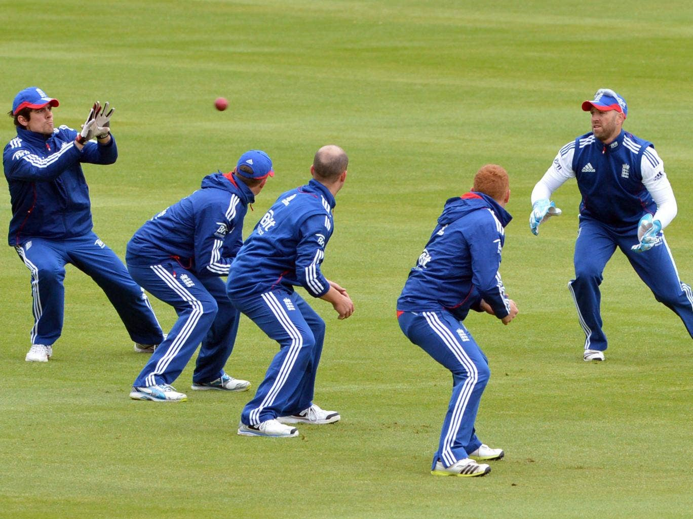 Alastair Cook takes a catch during a training session at Lord's yesterday