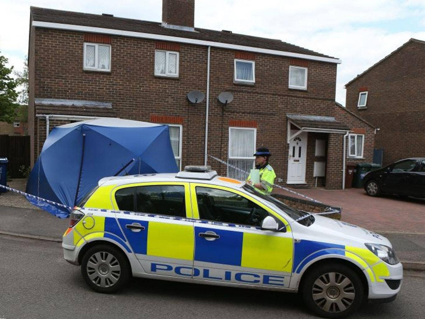 Police at the scene where the body of a two-year-old was found at a home after police were called to the address