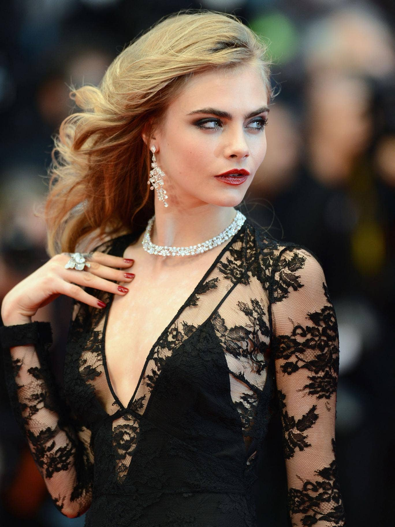 Cara Delevingne  wearing chopard jewels on the red carpet at the Cannes Film Festival